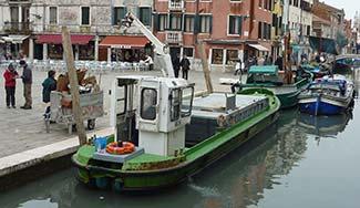 Venice garbage barge at the Campo San Barnaba