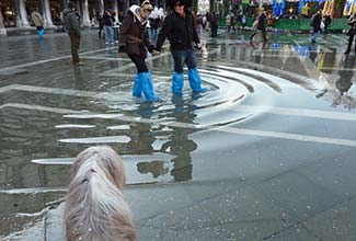 People in boots during Venice flooding