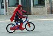 Spiderman on a bicycle in Venice