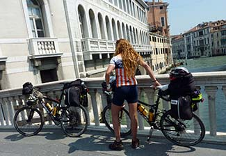 10_bicyclist_woman_w_2_bikes_on_bridge_325_p1070216