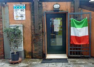Italian tricolor at the Accademia public toilets