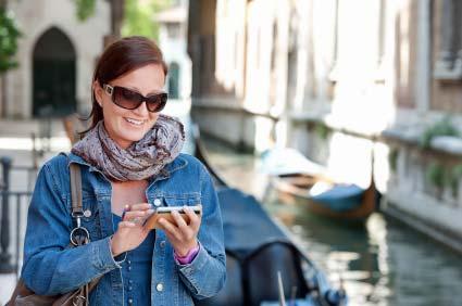 Mobile smartphone user in Venice, Italy