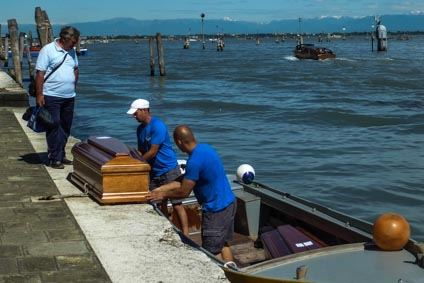 Coffin and boat in Venice