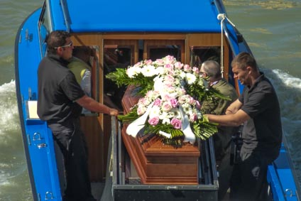 Coffin and funeral boat in Venice