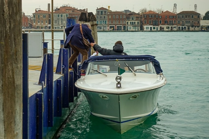 Man boards water taxi in Venice, Italy